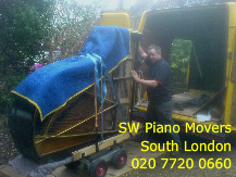SW Piano movers moving a 6ft grand piano